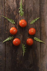 the cherry tomatoes on wooden background