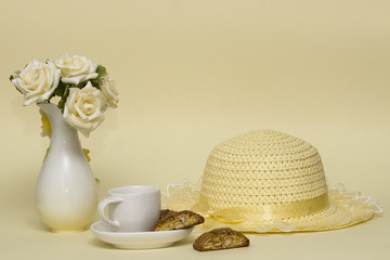 Breakfast setting with hat and flowers