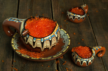 Red caviar in a vintage clay bowl