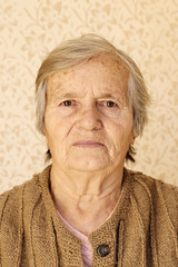 Closeup portrait, elderly lady looking at camera