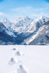 Footprints in fresh snow in the alps