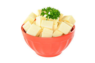 Red bowl with mozzarella cheese and parsley, white background