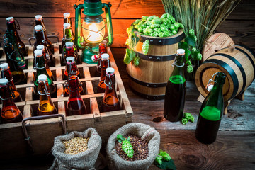 Ingredients for beer and bottles in the cellar