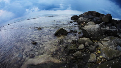 Tropical beach under gloomy sky. Fish-eye view