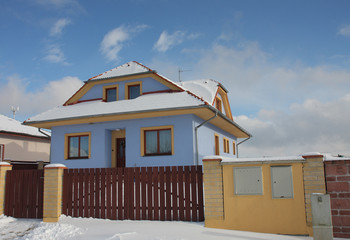 new modern house in village in winter