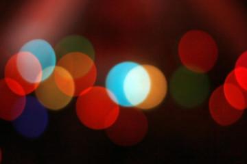 Abstract circular bokeh background on dark night