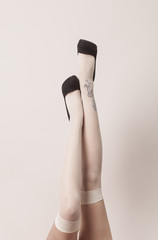 Female legs in sexy position wearing parisian stockings and heel