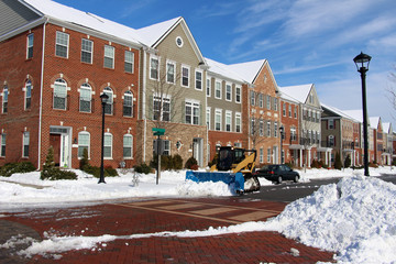 Snow removal around modern townhouses