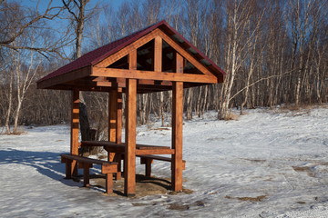 Picnic pavilion in winter forest