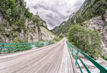 Wooden bridge through the Alps