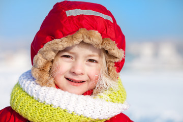 Winter portrait of a cute little girl with white frost on her ha