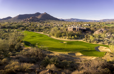 Wide angle high view point of desert golf course landscape
