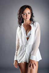 Image of seductive girl in unbuttoned blouse
