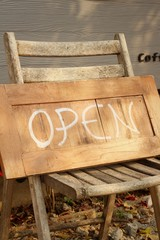Signs symbolize open on a wood background