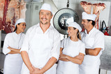 Male Butcher With Team In Butchery