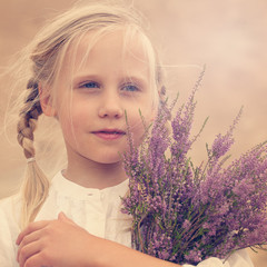 Carefree young girl with flowers outdoors
