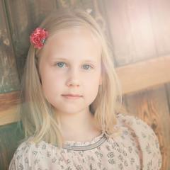 Portrait of little sunny blonde girl outdoors