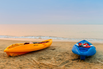 two kayaks on the beach early in the morning