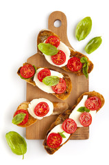italian bruschetta with cherry tomatoes, mozzarella & fresh basi
