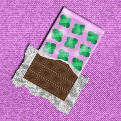 Chocolate bar with mint leaves on the package on pink fabric