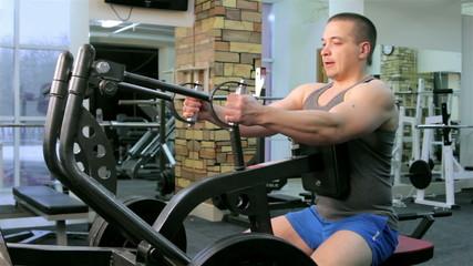 Man trains in a gym