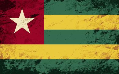 Togolese flag. Grunge background. Vector illustration