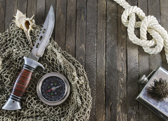 Fishing background with rope and knife