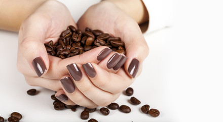 Brown manicure and coffee beans. © Vladimir Sazonov
