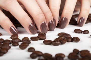 Brown manicure and coffee beans.