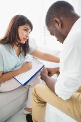 Therapist comforting her upset patient