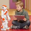 Child playing and learning with robot - 78359114