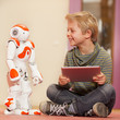 Child playing and learning with robot - 78359158
