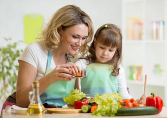 mother with kid make salad