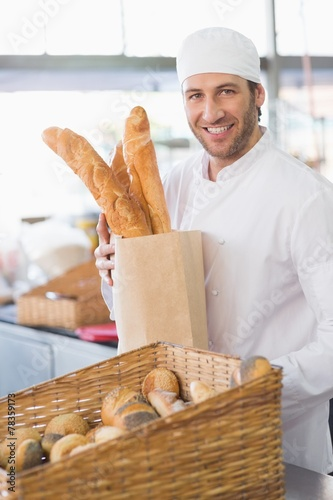Papiers peints Table preparee Baker showing basket of bread