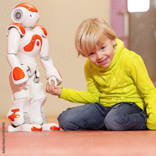 Child playing and learning with robot - 78359198