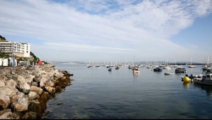 Brixham harbour and marina Devon England uk blue sky