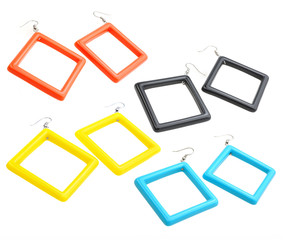 set of colourful plastic square earrings isolated on white backg