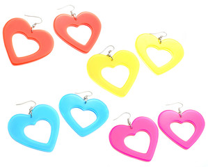 set of colourful plastic heart shaped earrings isolated on white