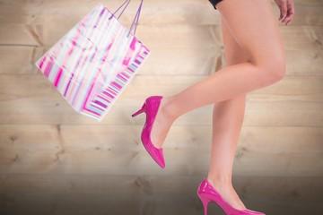 Composite image of womans legs in high heels