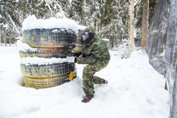 Military paintball training in winter with much snow