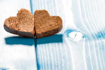Wooden Hearts on Wooden Background