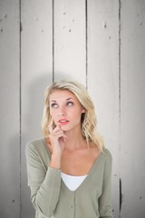 Composite image of pretty young blonde looking up
