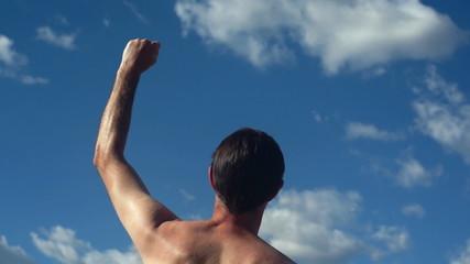 Male Back No Shirt Raising Victory Arms