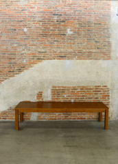Old brick wall and concrete texture and Long wooden chair