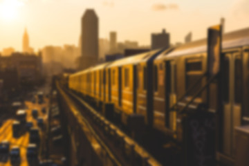 Subway Train in New York at Sunset. Blurred Background.
