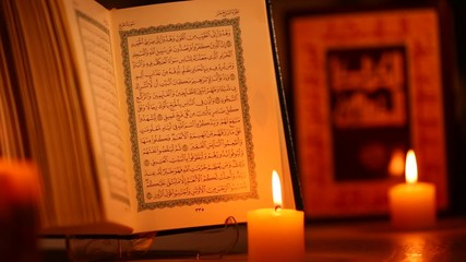 Quran and Bible, holy books of Islam and Christianity, dolly sho