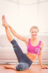 Athletic blonde sitting on floor stretching leg up