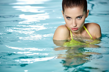 Beautiful woman resting in swimming pool