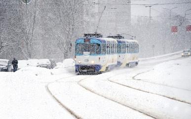 Winter. Movement of the tram during snowfall.