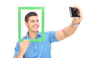 Man taking a selfie behind a picture frame